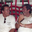 Arnold Schwarzenegger and Mario Kassar on a U.S. A
